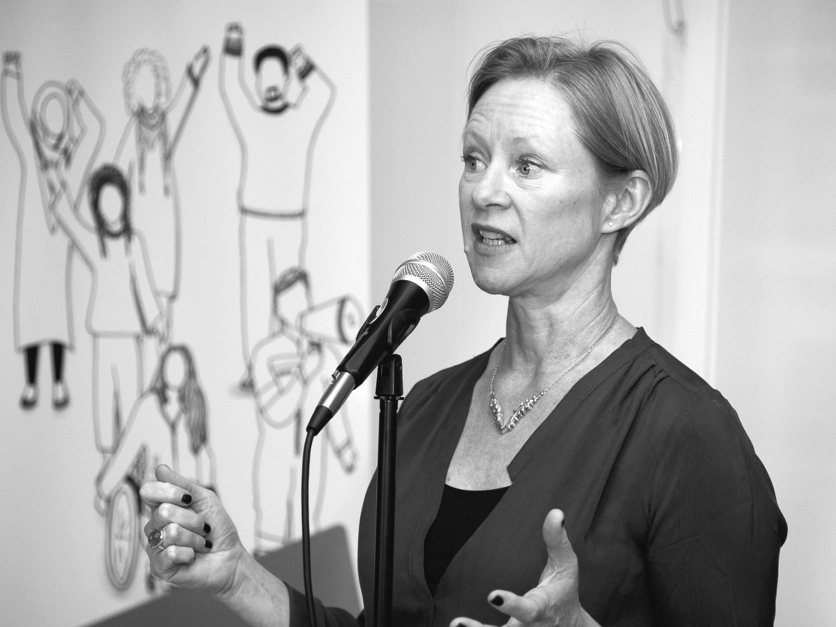 Image of Sue Tibballs, OBE, chief executive of Sheila McKechnie Foundation speaking at an event